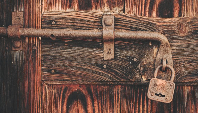Padlocked door - photo by Cristina Gottardi on Unsplash