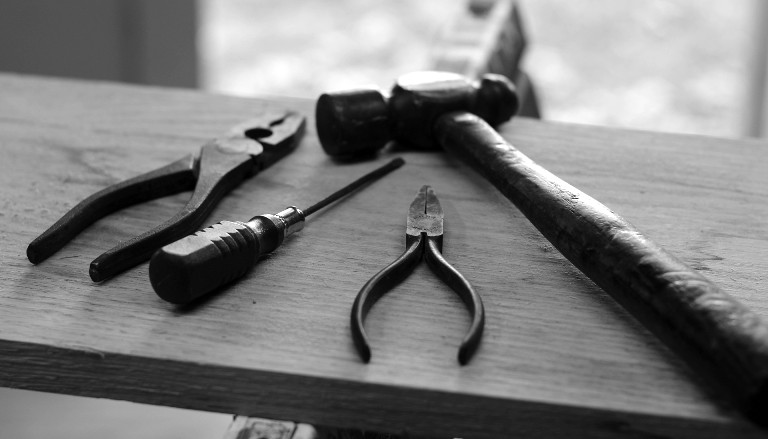 Tools on bench. Photo by Hunter Haley on Unsplash