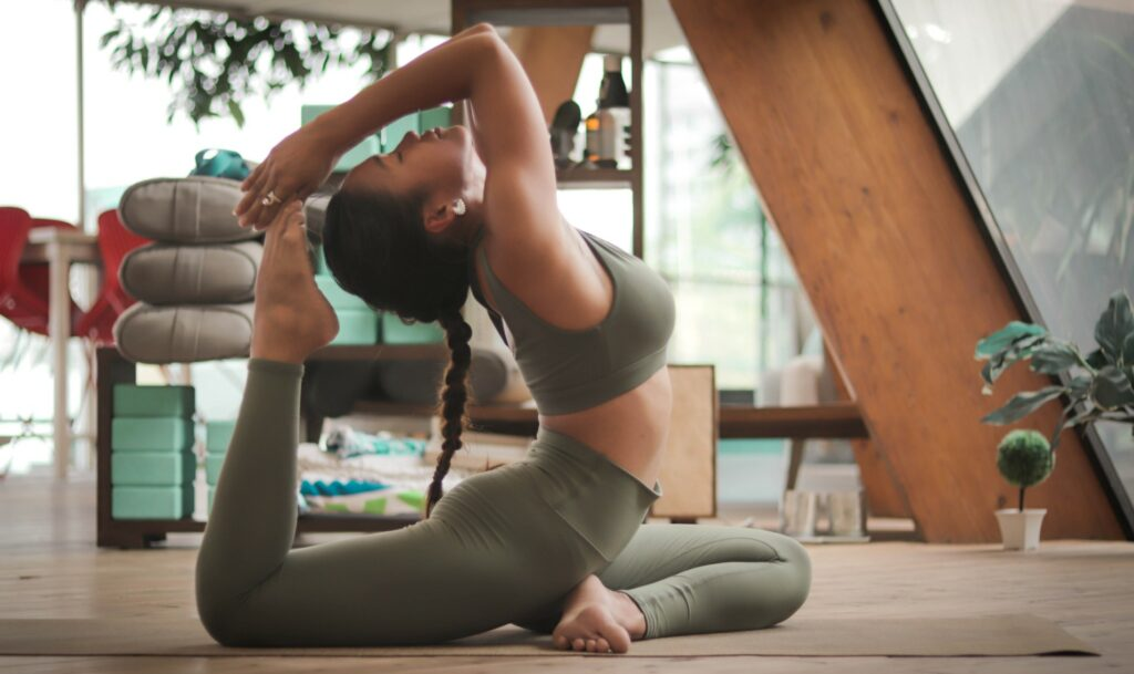 Woman practising yoga in a home studio