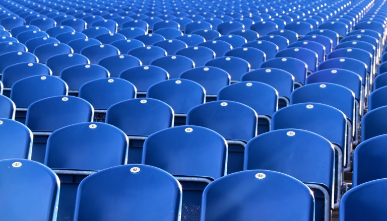 Empty seats in a stadium. Photo by Waldemar Brandt on Unsplash