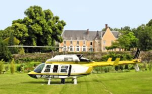 French chateau with a helicopter waiting on the lawn