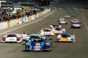 Robin leading the field at Le Mans (in the blue Gulf Kremer Porsche)