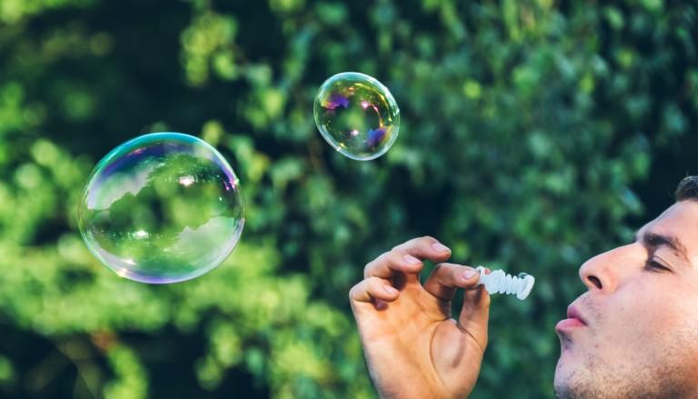 Man blowing bubbles