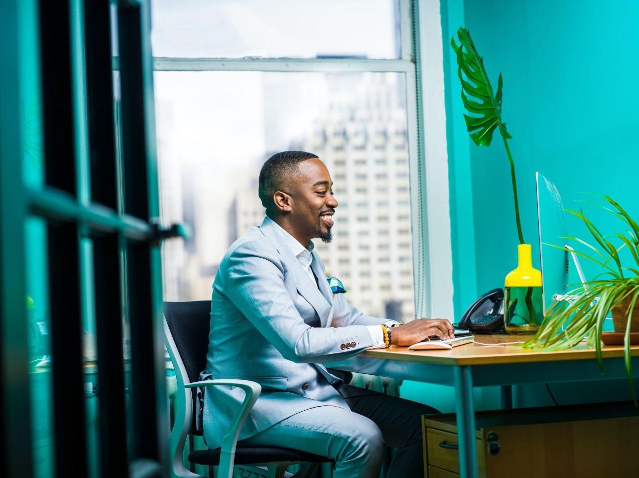 Man sitting by a keyboard working