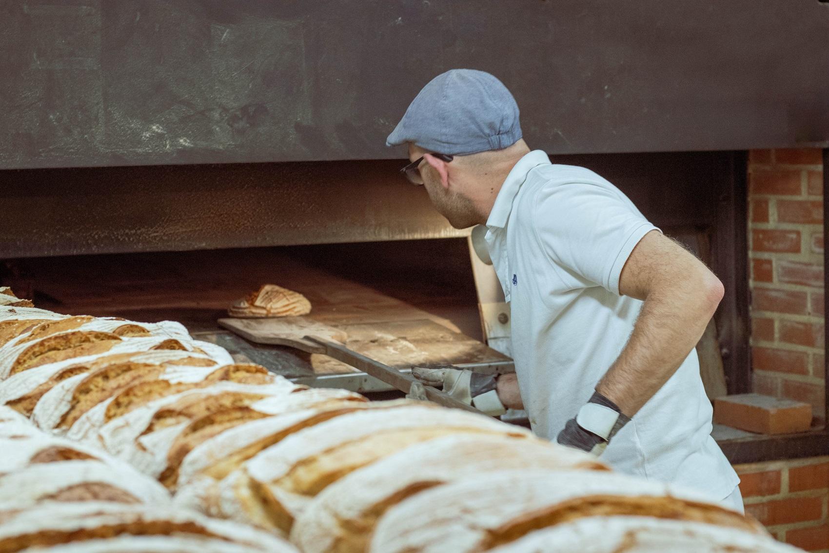 Baker at work. Photo by DDP at Unsplash.com