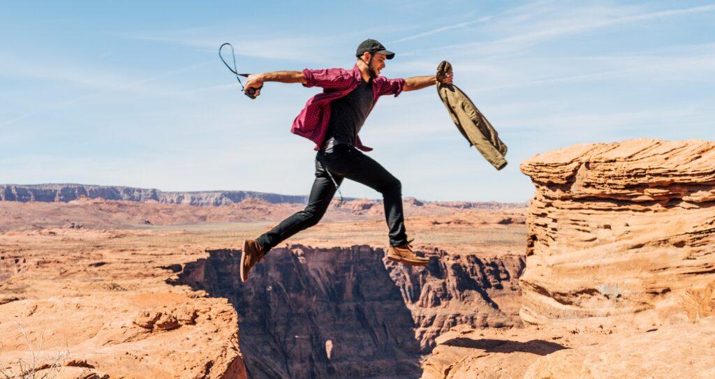 Man jumps over a ravine. Photo by Unsplash