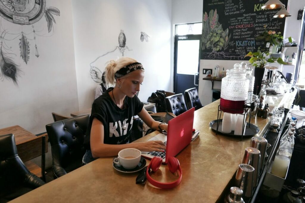 Lady works at laptop in coffee shop